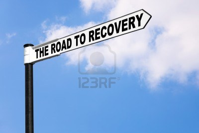 7971116-concept-signpost-image-for-the-saying-the-road-to-recovery-good-image-for-healthcare-or-financial-re