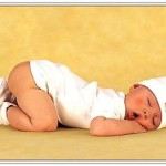 380664618_baby_in_white_in_deep_sleep_xlarge